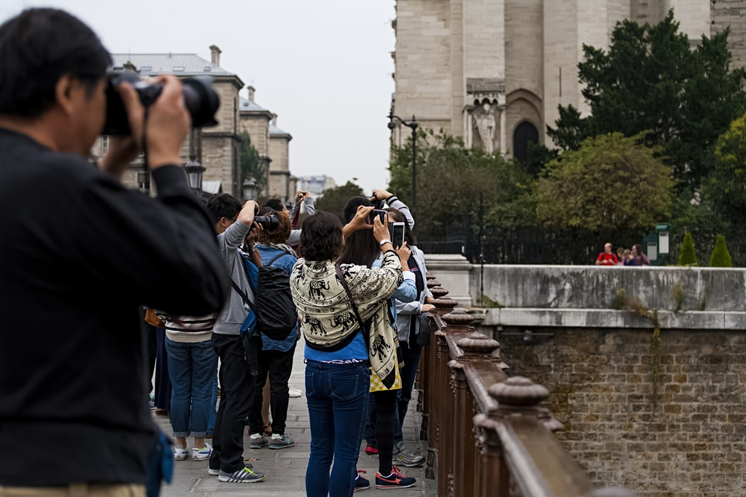 people taking photo of Paris architecture